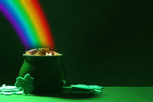 Pot With Gold Coins And Clover Leaves On Green Table, Space For Text. St. Patrick's Day Celebration