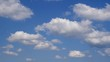 Cumulus clouds against the blue sky.