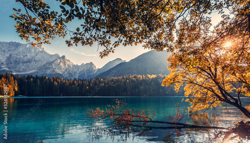 Fototapeta Impressively beautiful Fairy-tale mountain lake in Julian Alps. Breathtaking summer Scene. Panoramic view of beautiful mountain landscape in Alps with Fusine Lake with Mangart Mount on background.