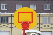 Yellow Stand With A Red Ring For A Basketball Sword
