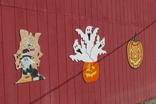 Beautiful Shot Of Halloween Artwork On The Side Of A Red Barn