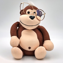 Sitting Toy Monkey In Fashionable Glasses