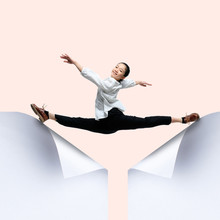 Imagine Who's Covering White Sheet To Get Digital File Icon. Young Woman, Ballerina Catching The Edge Of Huge Paper Sheet. Digital World, Funny Imagination Of The Way The Icon's Appearing.
