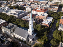 Aerial View Of Historic Downtown Savannah, Georgia With Church In Foreground.