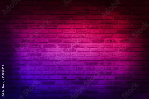 Neon light on brick walls that are not plastered background and texture. Lighting effect red and blue neon background of empty brick basement wall. - 324933579