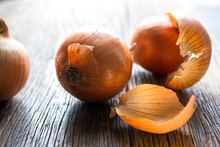 Onions Placed On Wooden Table
