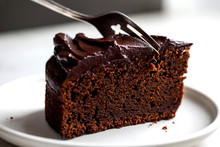 Close Up View Of Chocolate Cake Cutting With Fork