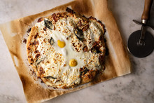 Directly Above View Of Pizza With Ricotta And Egg