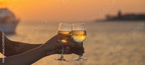 Drink wine by the sea. Selective focus.