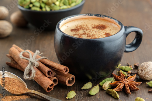 Cup of healthy ayurvedic masala tea or coffee, hot chocolate with aromatic spices Canvas Print