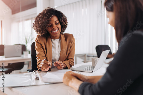 Photo Client consulting with a agent