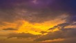 The flow of cloud against the sunset. Time lapse
