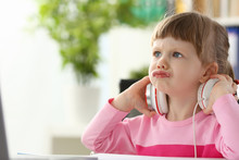 Little Girl Wearing Headphones Using Computer Aggressive Articulating Portrait