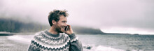 Young Man Walking On Beach Talking On The Mobile Phone Having Conversation Speaking To Someone During Nature Winter Walk Panoramic Banner Outdoor Lifestyle