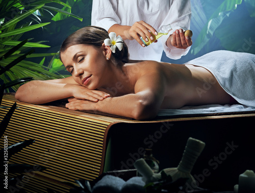 Fototapety, obrazy: oil massage of young beautiful woman in spa environment.