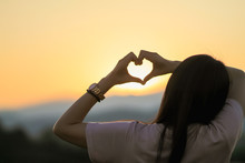 An Asian Woman Shows A Heart S...