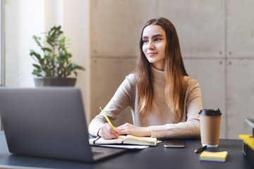Female working on laptop. Manager sitting at office desk and performing project using corporate software on PC. Career opportunities for young specialist, enterprise practice, distant online education