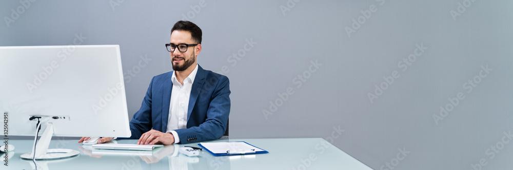 Fototapeta Businessman Working At The Office