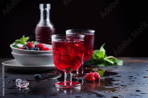 Photo Glasses of a red berry juice