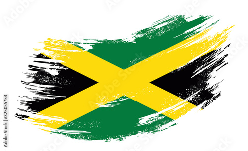 Photographie Jamaican flag grunge brush background. Vector illustration.