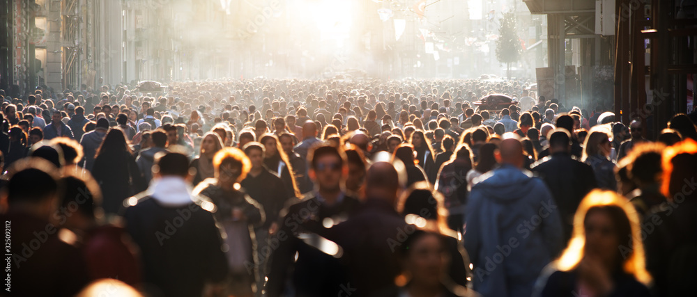 Fototapeta Blurred crowd of unrecognizable at the street