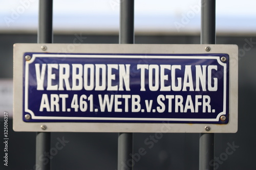Photo Typical dutch blue and white sign with text verboden toegang which means no ad