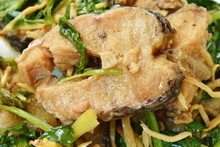 Deep Fried Slice Striped Snake Head Fish With Ginger And Celery On Dish