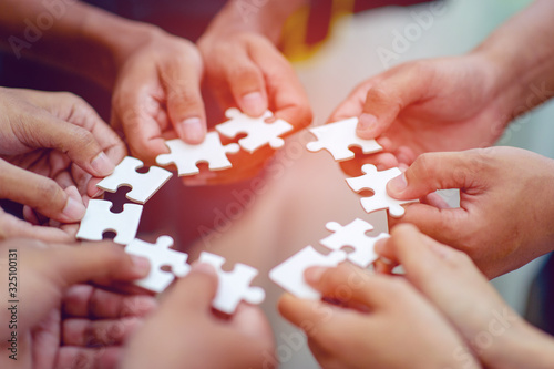 Team work, hands and jig Saw Unite with power Is a good team of successful people Team work concept