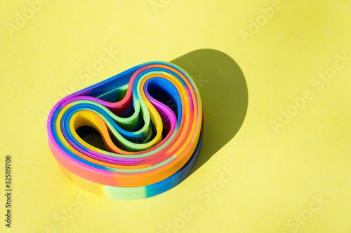 many bracelets with lgbt colors in yellow background Canvas Print