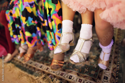 Fotografía Children's legs in a ballroom dancing shoes ready to dance competition