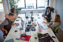 Group Of Employees Talking, Wo...