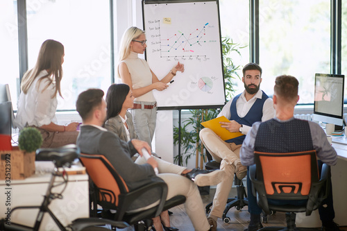 group of colleagues at casual business meeting, brief. casual, office, business concept