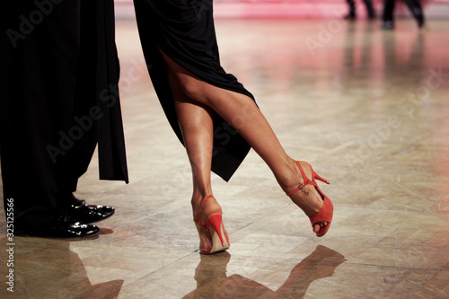 Beautiful line of feet of woman in red dress dancing Argentinian tango Canvas Print