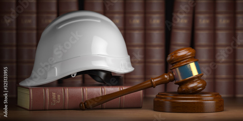 Canvas Labor law concept. Gavel  with concstruction hard hat and books.