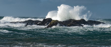 Massive Waves Crash Over The Rocks At Ballintoy Harbour, Causeway Coast, Northern Ireland