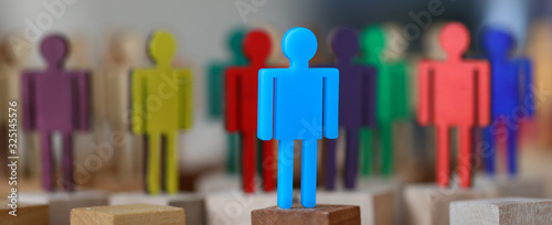 Fototapeta Group multi-colored silhouettes business people teamwork meeting closeup background. Social media marketing advantage leader concept obraz