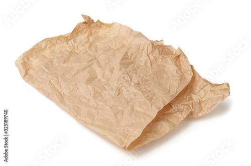 Valokuva folded brown crumpled sheet of parchment paper isolated on white background