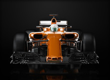 Motor Sports Competitive Team Racing. Sleek Generic Orange Race Car And Driver With Front View Perspective, Studio Lighting And Reflective Background. 3d Rendering