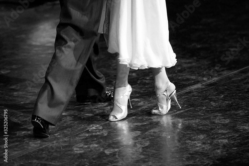 Graceful lines of legs of Argentina tango dancers in black and white Canvas Print