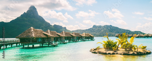 Fotografia, Obraz Bora Bora French Polynesia luxury hotel resort overwater bungalow suites in Tahiti, Honeymoon travel destination header panorama background