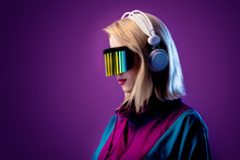 Blonde In VR Glasses And Headp...