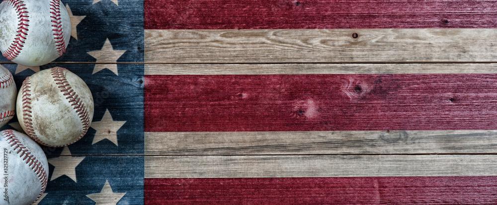 Fototapeta Old baseballs on vintage wooden USA Flag background with copy space