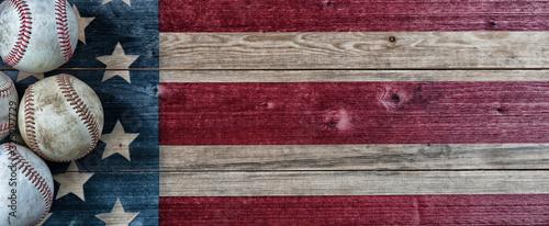 Fototapeta Old baseballs on vintage wooden USA Flag background with copy space obraz
