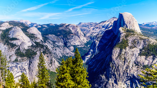 The Yosemite Valley in the Sierra Nevada Mountains with the famous Half Dome granite rock formation on the right Canvas Print