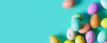 Colorful Easter Eggs On Pastel Blue Background. Creative Design. 3d Rendering