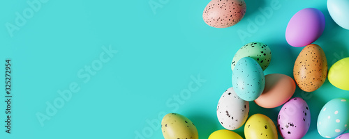 Fototapeta Colorful Easter eggs on pastel blue background. Creative design. 3d rendering obraz