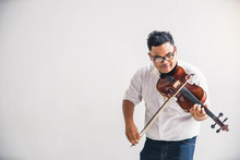 Symphony Orchestra On White Background, Hands Playing Violin. Male Violinist Playing Classical Music On Violin. Talented Violinist And Classical Music Player Solo Performance.