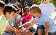 Positive Children Holding Hands And Giving Friendship Vow