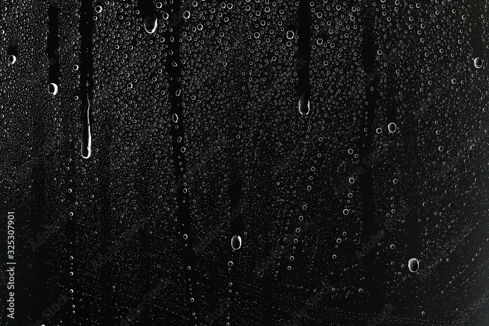 Fototapeta black wet background / raindrops for overlaying on window, concept of autumn weather, background of drops of water rain on glass transparent