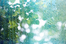 Summer Rain Wet Glass / Abstract Background Landscape On A Rainy Day Outside The Window Blurred Background